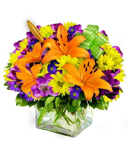 Warm_And_Vibrant_Flowers_In_A_Cube_Vase